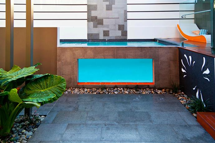 "The owners of this Brisbane property wanted to modernise their 6x3m pool, so they turned to Aaron Worth of [Utopia Landscape Design](http://www.utopialandscapedesign.com.au/|target=""_blank""). He cut a window in the pool wall and sealed it with an acrylic panel, creating a focal point that can be enjoyed from the house. The rest of the palette consists of grey and black granite tiles, river pebbles and merbau decking."