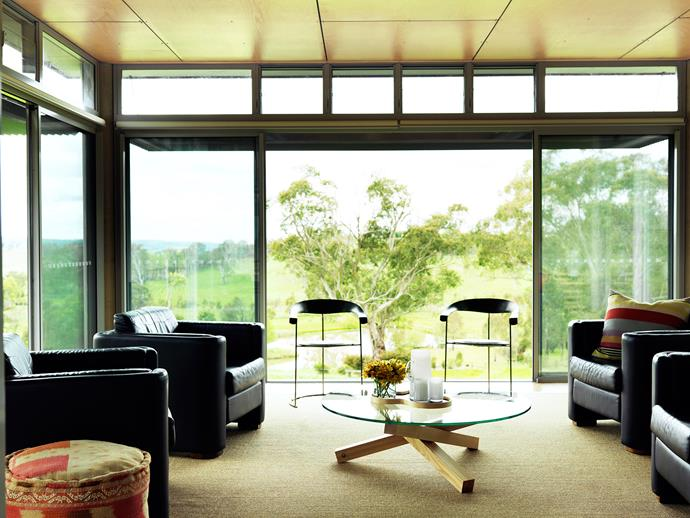 """Architect Peter Stronach's """"10 principles of sustainable design"""" focus on [efficient ways to utilise natural light and heating](http://www.homestolove.com.au/what-to-consider-when-designing-a-sustainable-home-3861 target=""""_blank""""). In the sunroom, floor-to-ceiling glass affords panoramic views, and the double-glazing prevents solar gain and heat loss. Sliding doors allow breezes to cool the house in summer."""