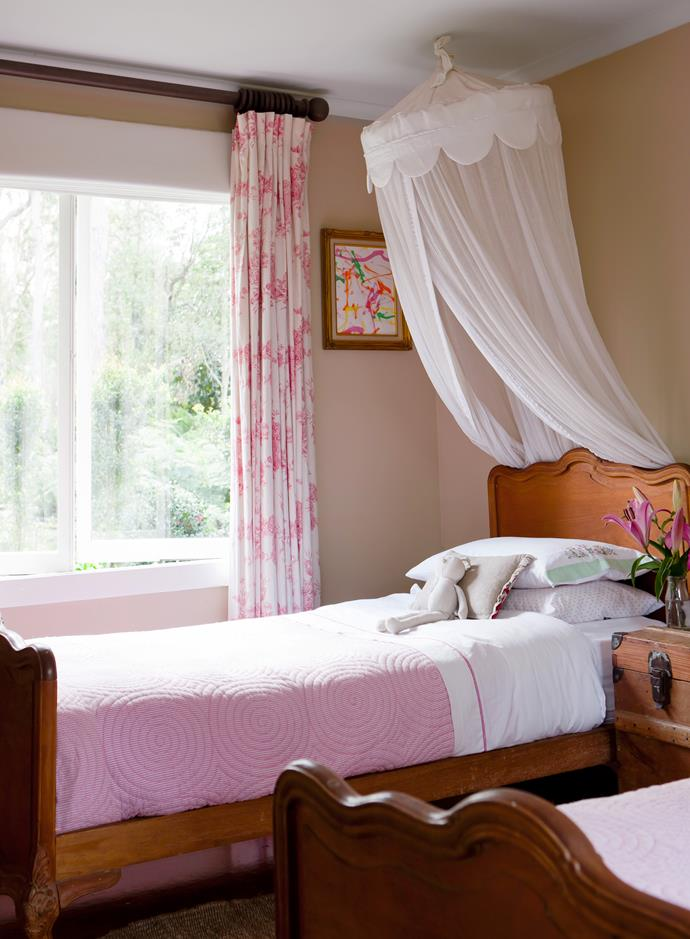 The girls' bedroom is a pink haven. The antique timber beds, which came from Philippe's grandparents' house in South Africa, are among many cherished heirlooms dotted throughout the house.