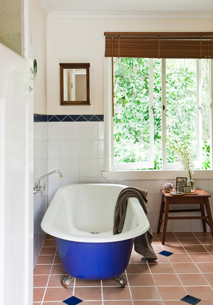 The bathroom is a triumph of recycling; cast-iron bath from demolition yard, oak table from a secondhand shop and the tiles were leftovers from Philippe's projects.