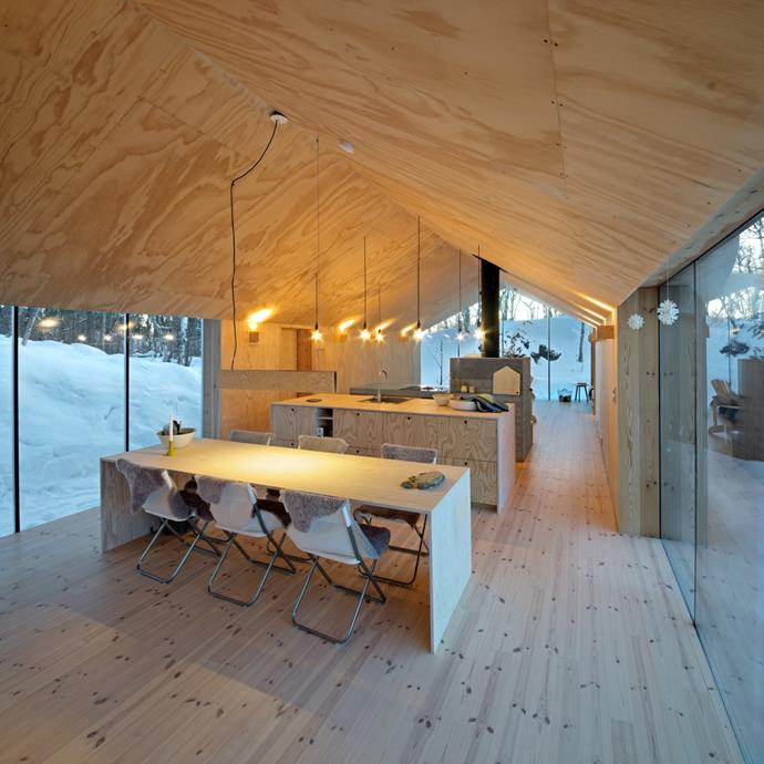 The interior are lined with untreated plywood sheets to echo the surrounding birch forest. *Photo: Reiulf Ramstad Arkitekter*