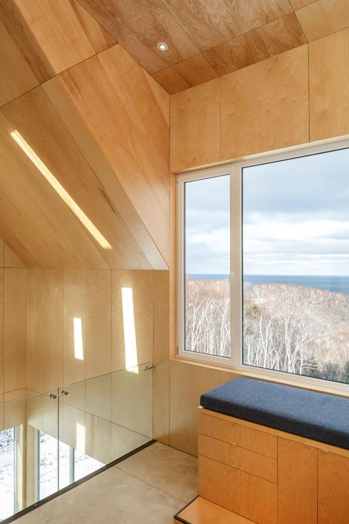 "The tall timber-clad cabin was designed by New York architects [Design Base 8]( http://designbase8.com/ |target=""_blank"") and local architect [Omar Gandhi](http://omargandhi.com/