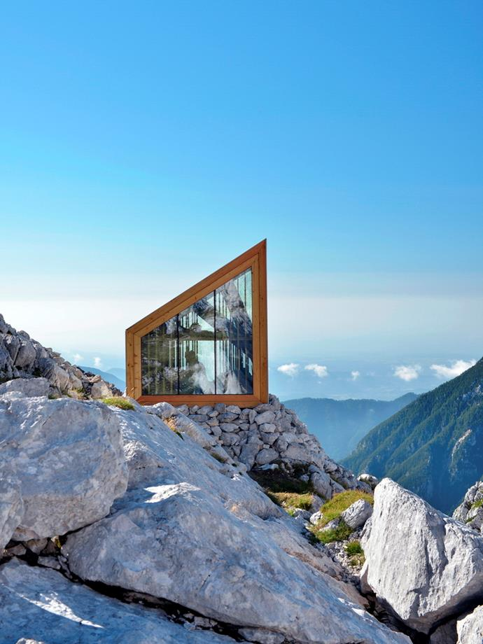 Perched on a rocky outcrop below Skuta Mountain in Slovenia, this tiny cabin can shelter up to eight mountaineers. *Photo: by Janez Martincic*