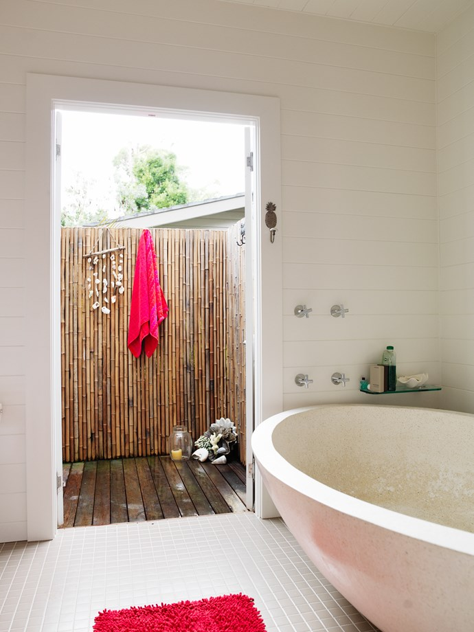 Monique had the freestanding terrazzo bathtub made in Bali; it's just a step from here to an outdoor shower.