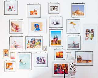 travel photos on a feature wall