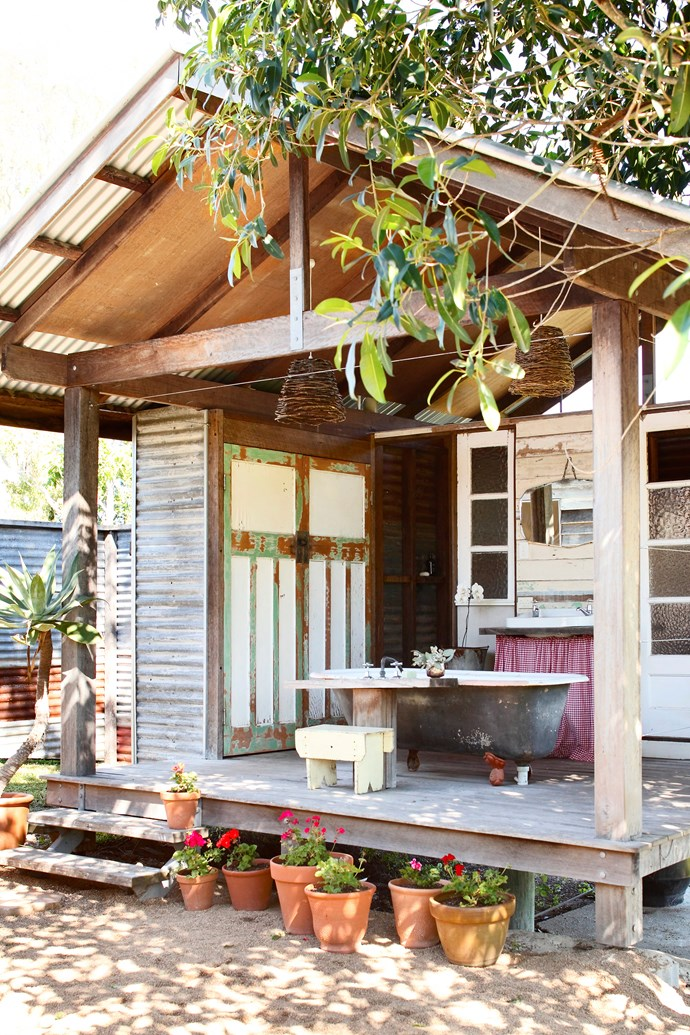 This separate bath house was constructed from recycled materials and new timber.