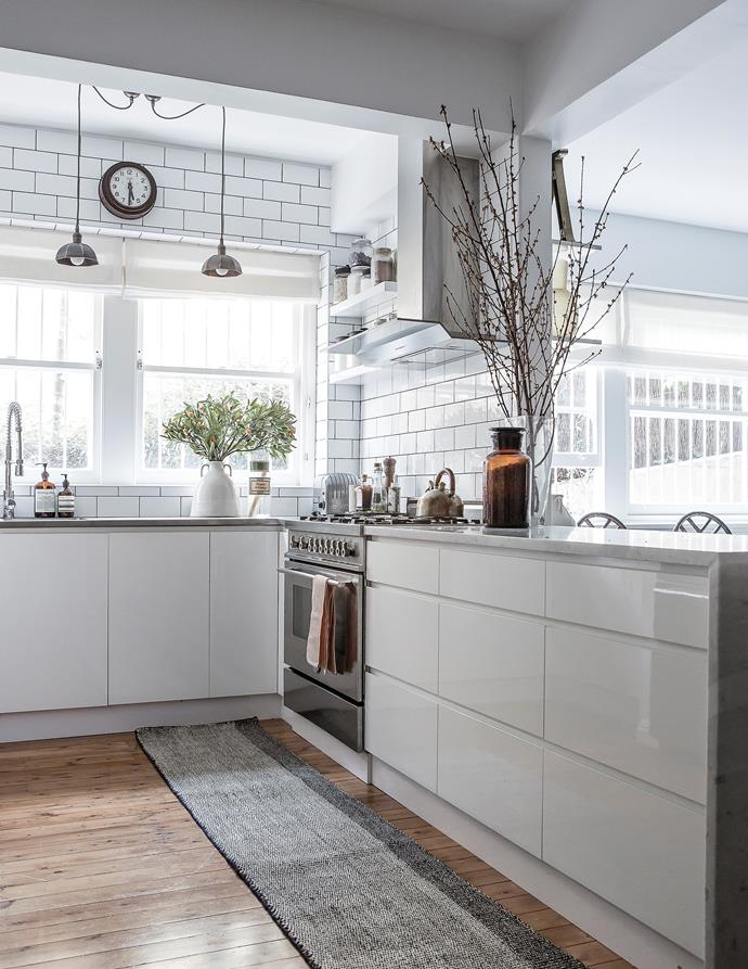 """""""The kitchen was designed around the subway tiles with dark grout,"""" says Kate."""