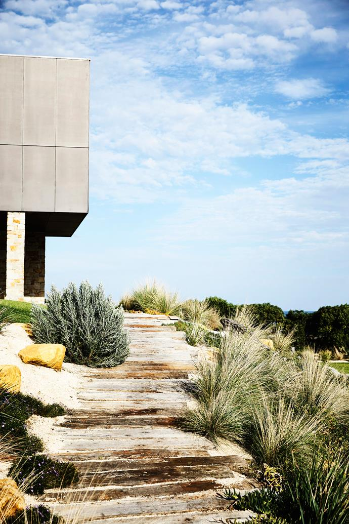 At their first meeting, the owners presented architect Fiona Dunin with their mood board: a jar of golden sand, a rock and photos of the home's spectacular location.