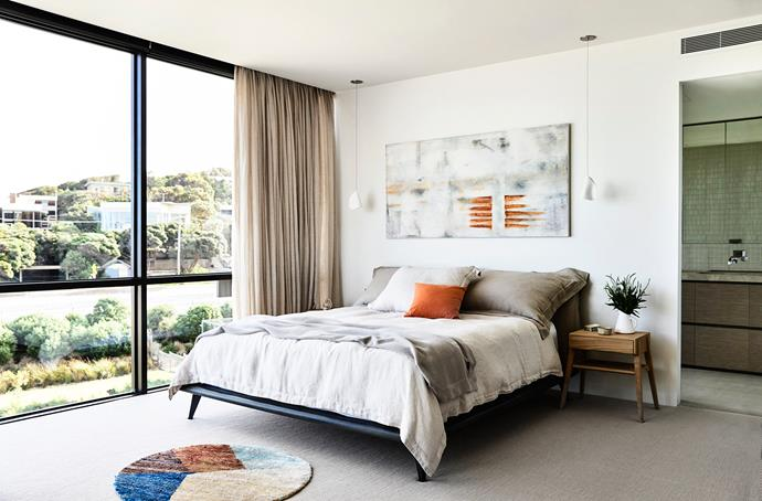 In the bedroom, shell-shaped ceramic pendants are suspended on either side of the bed.
