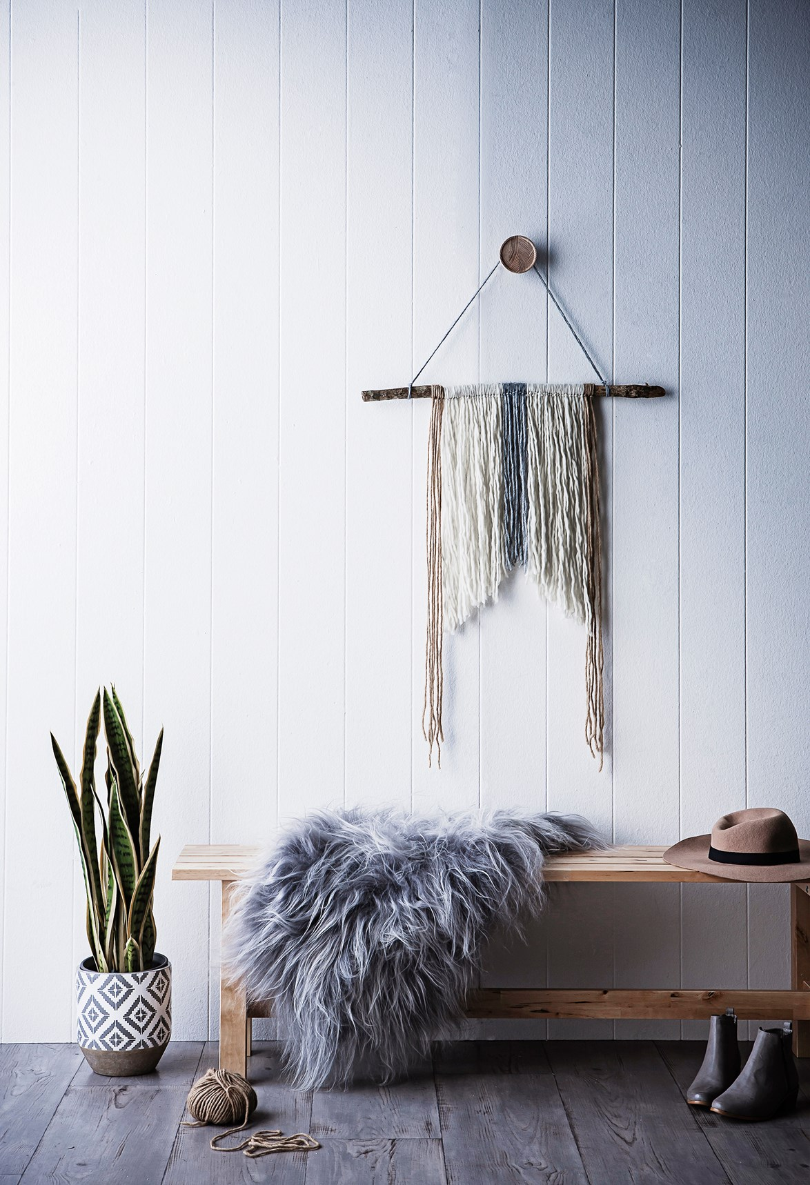 Love the look of woven or macrame wall hangings but don't have the skills to make your own? Try this DIY branch wall hanging. It has that bohemian edge, and is super easy to make.