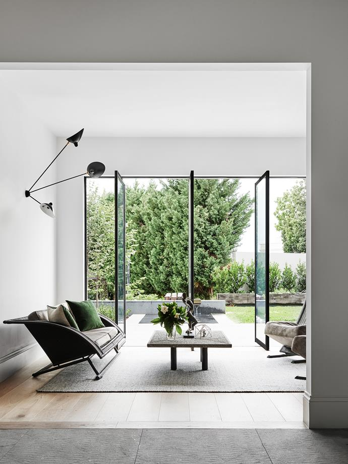"New, expansive, floor-to-ceiling steel-framed glass pivot doors overlook a garden landscaped by [Jack Merlo](http://jackmerlo.com/?utm_campaign=supplier/|target=""_blank"")."