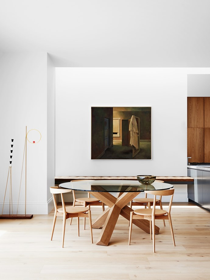 A rectangular dining table was replaced by a more casual round table, an existing piece that was re-stained.
