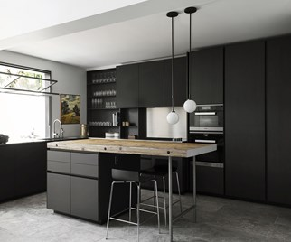 black kitchen cabinetry and pendant light