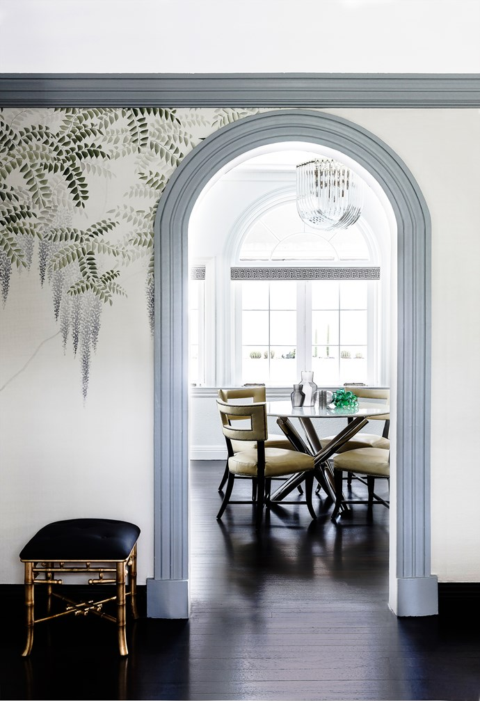 """The designer was prompted by the owners to include """"something handpainted"""" in the formal sitting room and selected the delicate De Gournay silk wallpaper for the walls."""
