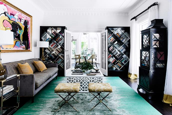 In the library, Brendan created crosshatched bookshelves in glossy lucite and mirror to give a sense of continued depth.