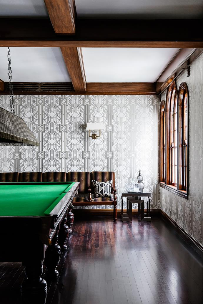 The 1930s billiard table is in mint condition. 'Metropolis' wallpaper by Catherine Martin.