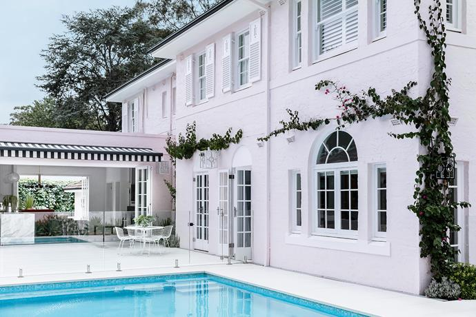 French doors were installed to open up the house to the revamped poolside enteraining area.