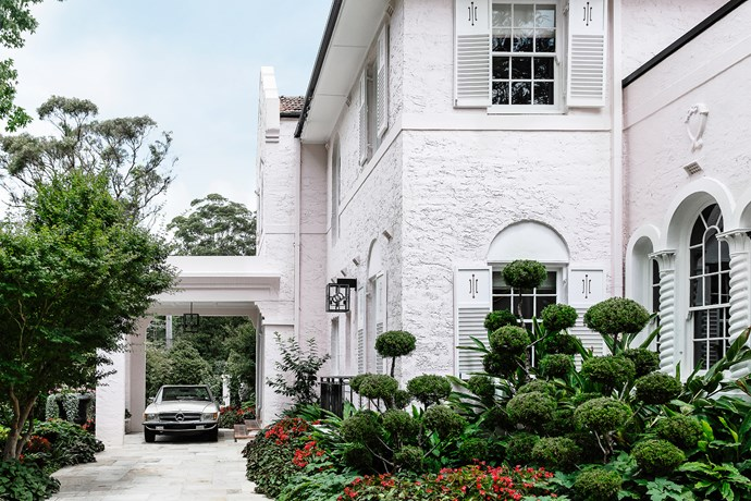"""The porte-cochère provides a grand entrance to the home. The garden was created by Richard Unsworth of [Garden Life](http://www.gardenlife.com.au/home 