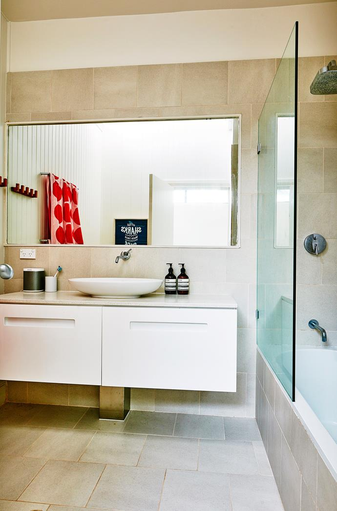 "A wall-hung vanity and large mirror make the [bathroom](http://www.homestolove.com.au/6-budget-bathroom-updates-3599|target=""_blank"") seem bigger."