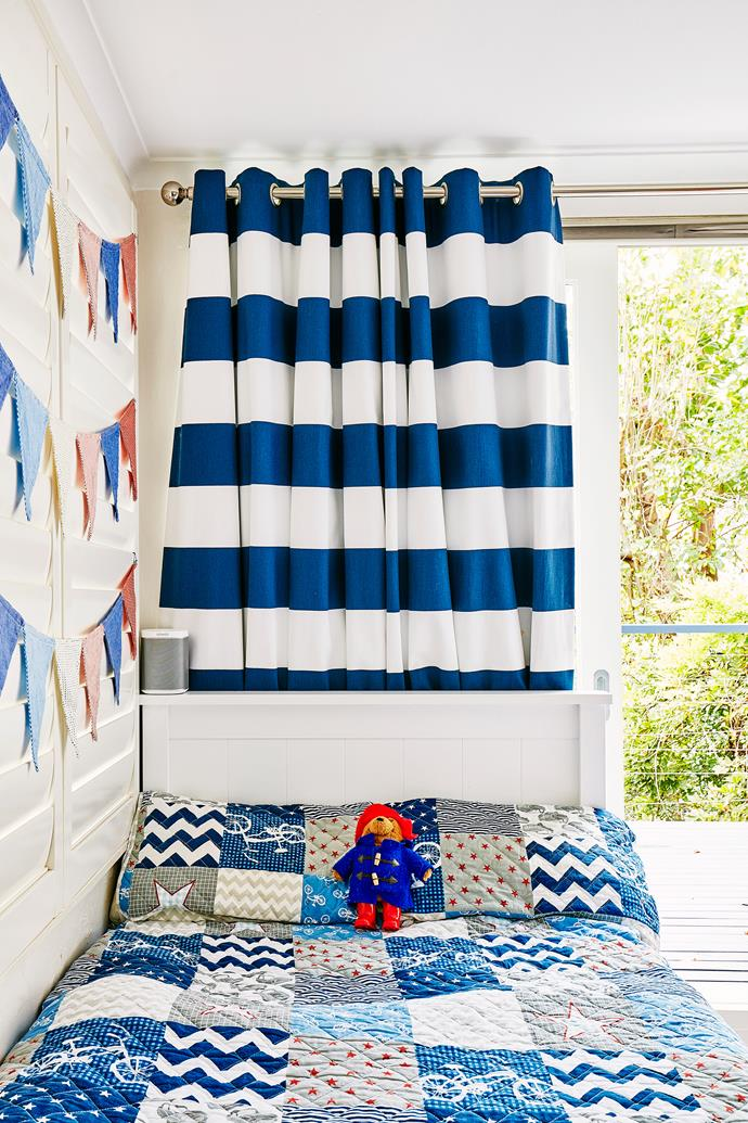 "A patchwork-style quilt from [Adairs](https://www.adairs.com.au/|target=""_blank"") is a focal point of the boys' room."