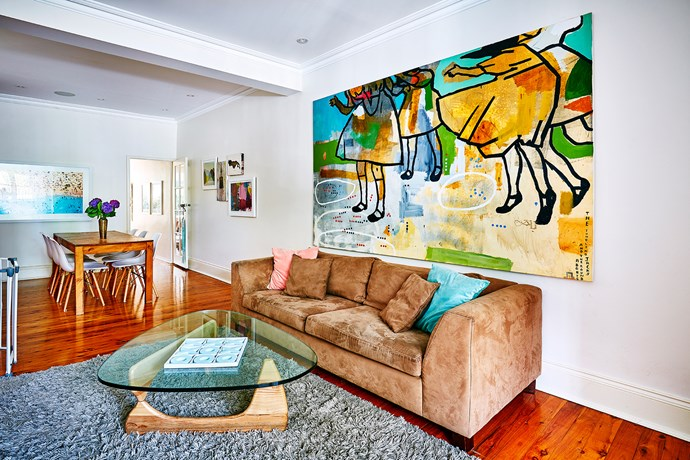 "Works like this huge painting by [Jacob Logos](http://www.jacoblogos.com/|target=""_blank"") add life to neutral walls throughout the house."