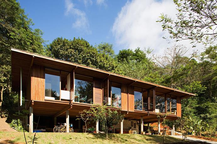 "**Vila Taguai - Carapicuiba, São Paulo** This residential project, by architect [Cris Xavier](http://www.cristinaxavier.com.br/?utm_campaign=supplier/|target=""_blank""), comprises of eight wooden houses nestled among the city's surrounding greenery. *Photo: Daniel Ducci*"