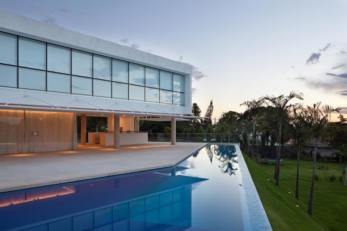 Outside, a luxurious pool wraps around the deck. *Photo: Haruo Mikami*
