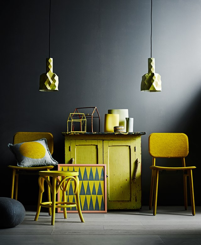 """Two-door cabinet in Yellow with painted zinc top, Tarlo & Graham. Ligne Roset """"Felt"""" dining chairs in Moutarde, Domo. Round 46cm barstool, Thonet. Faceture pendants in Yellow, The Minimalist."""