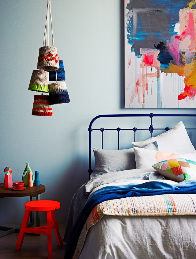 """Scout iron double bed in Space Blue, Scout House. Cross base side table, Mark Tuckey. Tom Dixon """"Eclectic"""" offcut stool in Fluoro, Safari Living. HK Living 5-shade multiple light, House Of Orange."""