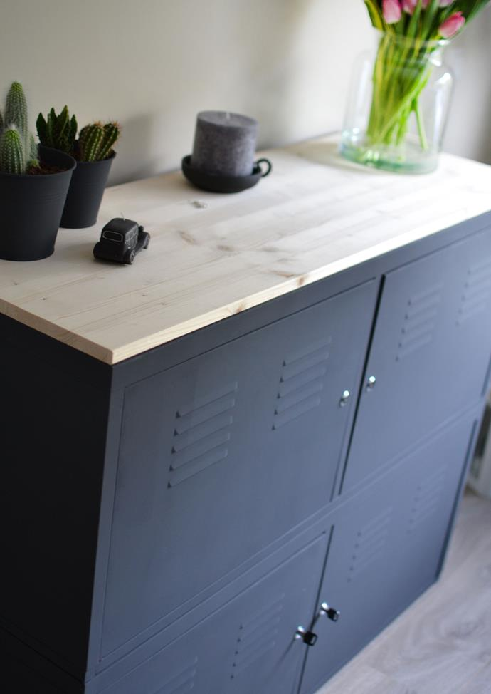 "Two [IKEA PS](http://www.ikea.com/au/en/catalog/products/30292318/|target=""_blank"") cabinets have been transformed into an über cool sideboard with some matte black paint and a timber counter-top."