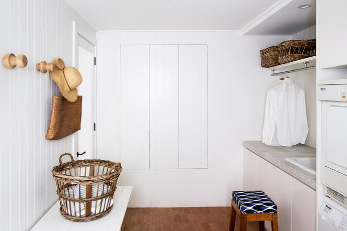 "For maximum functionality, a set of sorting drawers, a pull-down ironing board and a clothes chute were included in the laundry of [Sydney interior designer Annie Benjamin](http://www.anniebenjamindesign.com.au|target=""_blank""). There's ample room for sorting and folding clothes and the terracotta floor tiles are robust for this hard-working space. *Photo: Jason Busch*"