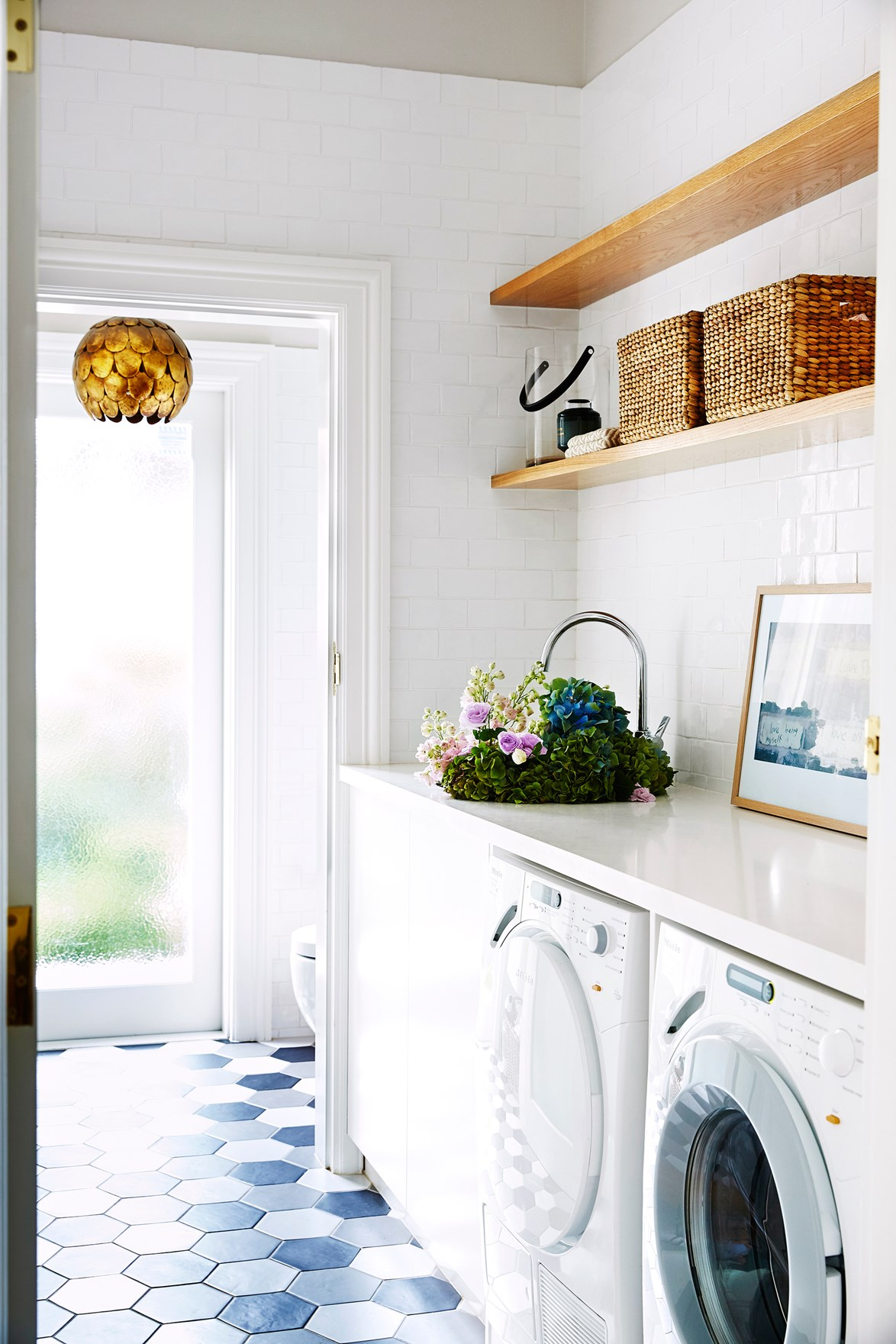 This laundry room is part of an extension to a Federation home, so interior designer Brett Mickan selected finishes and fittings to mimic its period detailing. Photo: John Paul Urizar