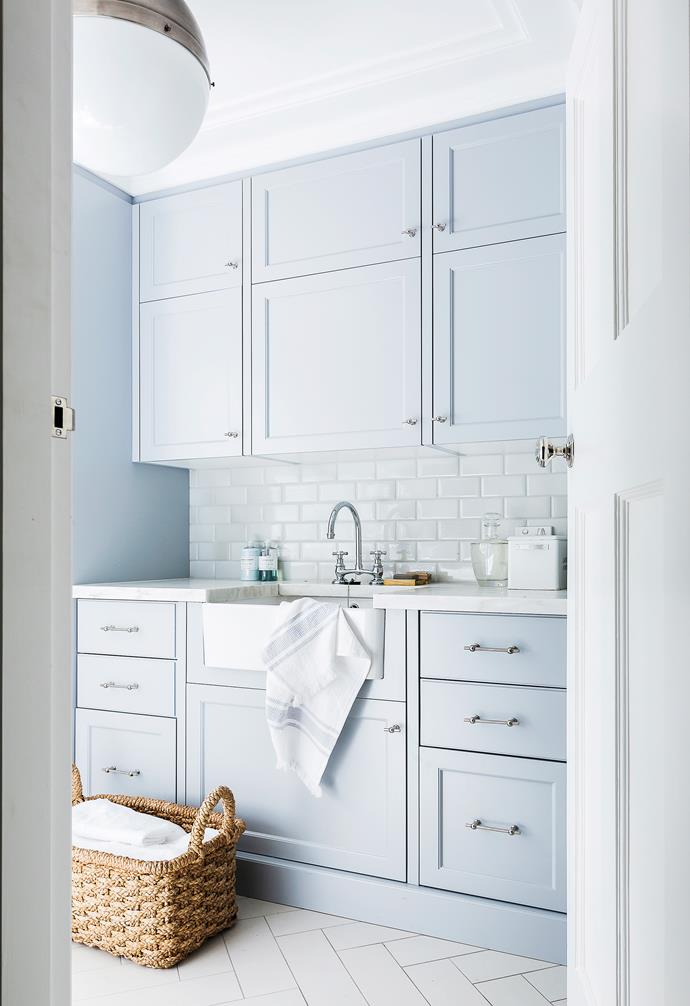 "This beautiful, classically appointed laundry was designed by [Coco Republic](https://cocorepublic.com.au|target=""_blank"") to suit an Art Deco-style home. The custom-made timber cabinetry is combined with subway tiles in a decorative replica-crackle finish and a Corian benchtop in Witch Hazel. Photo: Maree Homer 