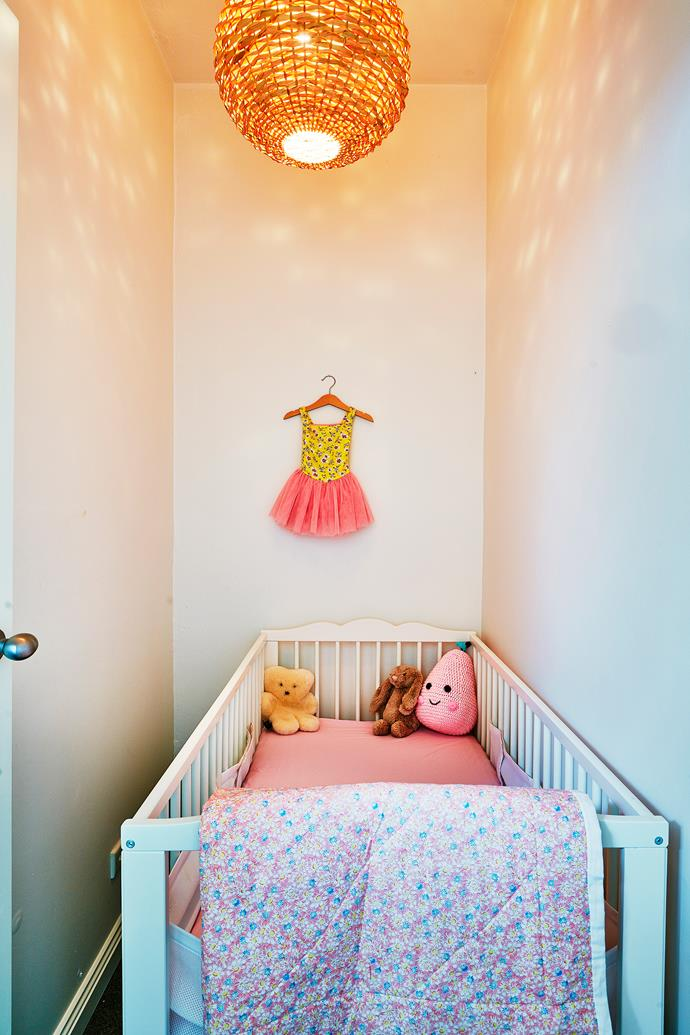 A tiny ballet dress hanging above the cot is an inexpensive way to inject personality into this nursery. Photo: bauersyndication.com.au