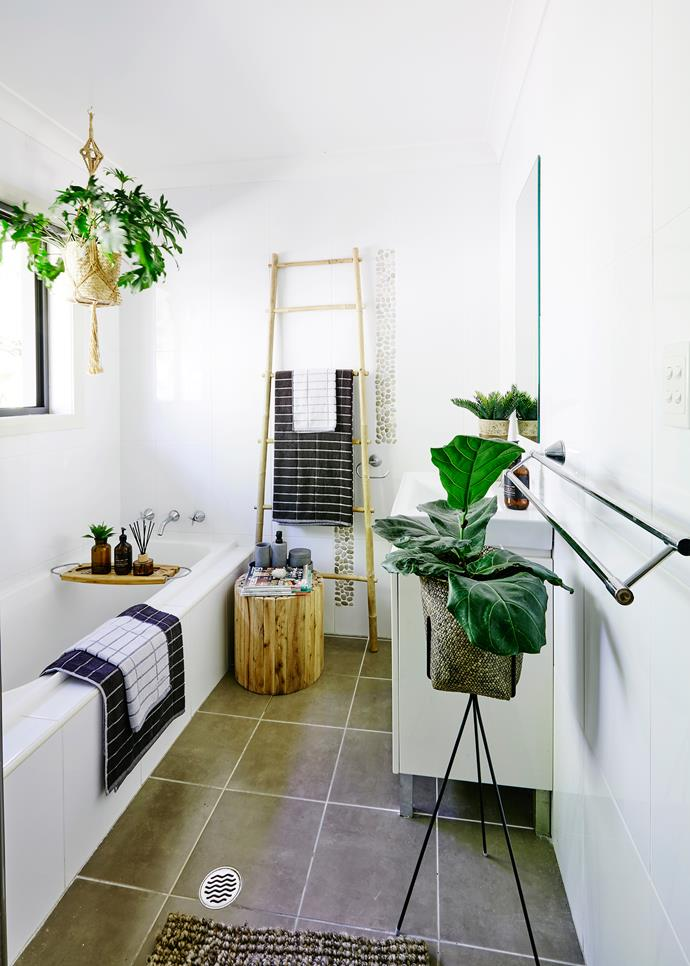 Penny updated the bathroom with timber elements and towels in a colour that won't date.