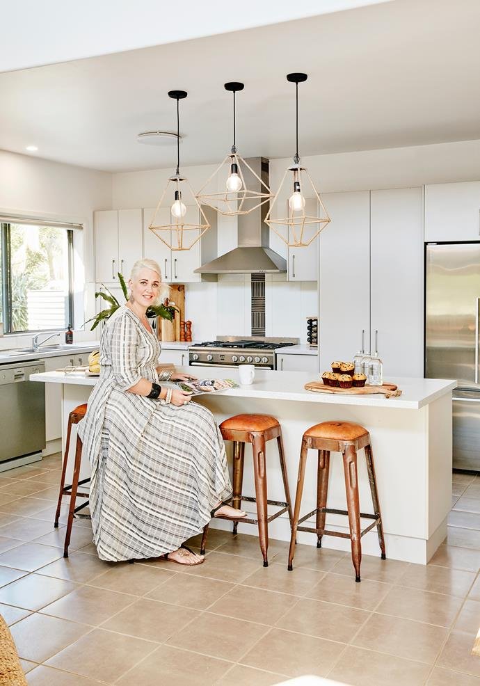 "Penny's kitchen is classic white with warm timber elements and [industrial touches](http://www.homestolove.com.au/how-to-incorporate-an-industrial-look-at-home-3740|target=""_blank"")."