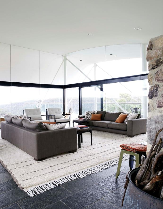 "In the open-plan living/dining area of this [Harry Seidler-designed house](http://www.homestolove.com.au/harry-seidlers-award-winning-modern-marvel-2905|target=""_blank""), an over-sized area rug creates an identifiable living 'zone' and adds warmth to the stone flooring. Photo: Richard Powers"