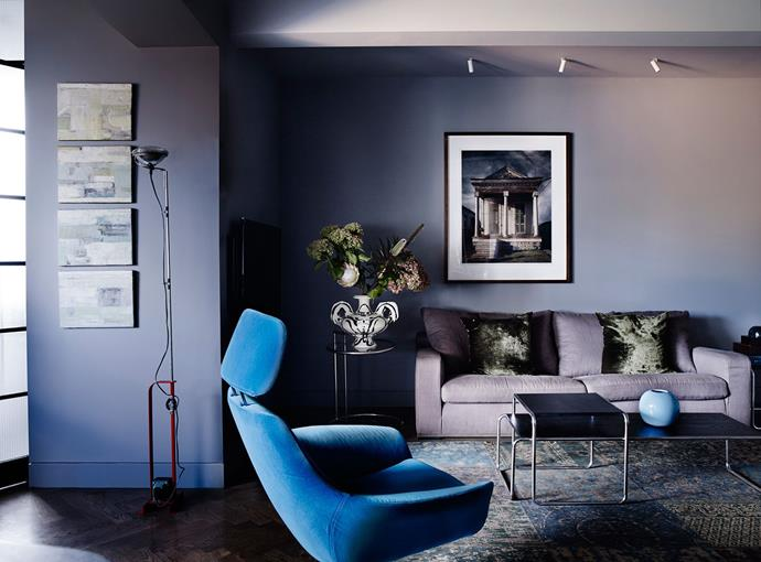 "An electric blue armchair stands out among the deep purple tones of this living room. Take a tour of the renovated ['20s home](http://www.homestolove.com.au/robert-and-susans-converted-20s-harbour-view-apartment-1989|target=""_blank""). Photo: Prue Ruscoe"