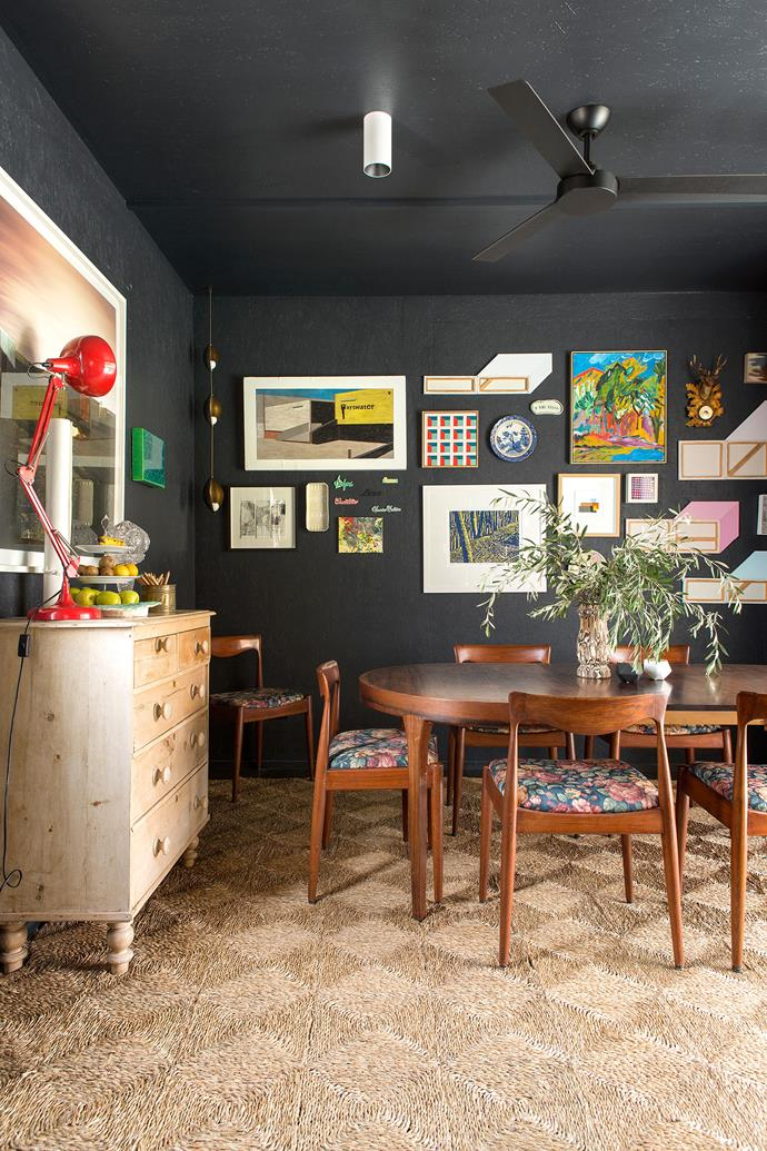 """Dark Star by [CODA Studio](http://coda-studio.com/ target=""""_blank"""").  You'd never know that this Perth dining room is situated in a transportable building. """"When we built our new family home we retrofitted it and this area became our dining room, kitchen and laundry,"""" says Emma Williamson, architect and the owner of this home. The painted oriented strand board brings texture to the room and is a striking backdrop to all the paintings and objects that adorn the wall. For visual balance, the floor has been laid with pale straw square carpet. """"This room remains a sacred space in the house that's not overtaken the chaos of a busy life of work, homework and play."""" *Photography by Angelita Bonetti.*"""