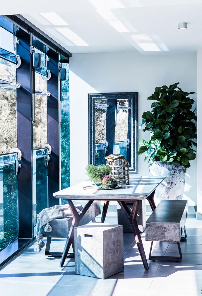 """Outside Interests by [Marylou Sebel Interior Design](http://www.marylousobel.com.au/ target=""""_blank""""). To make this Melbourne pied-a-terre feel like home for her clients Marylou Sobel focused on the notion of bringing the outdoors in. In a nod to the park views from this space she opted for a clean-lined concrete table and bench seating on the generous balcony. """"The mirror reflects the surrounding greenery and draws it in,"""" she says. """"Sitting at the table you feel as though you're suspended above nature."""" *Photography by Maree Homer.*"""
