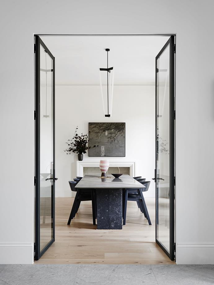 """Time Table by [Robson Rak Architects and Interior Designers](http://robsonrak.com.au/ target=""""_blank""""). It was a case of back to the future for this dining room, part of a home renovation in Melbourne's south east. The brief to Robson Rak architects and interior designers was to modernise a 30-year- old room, making it more entertainer-friendly by adding a service door to the kitchen and a bar area behind bifold doors. """"We love the marble table, which brings the whole room together. It can be used for dinners, but is often strewn with beautiful objects, flowers and sculptures."""" *Photography by Brooke Holm.*"""