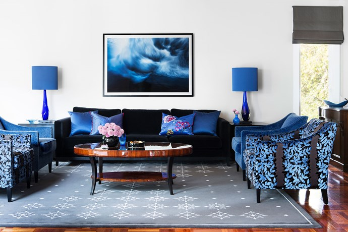 """Sing The Blues by [Camilla Molders Design](http://camillamolders.com.au/ target=""""_blank""""). Intended as an adults' conversation area in a large family home, this room banishes the bland – on her first visit, interior designer Camilla Molders was met with a """"blank canvas"""", with plain walls (although it was redeemed by the gorgeous parquetry floors). But now Camilla's moody blue palette gets everyone talking. """"Blue was the inspiration for this scheme and introduced to balance the red of the beautiful parquetry,"""" she says. Pattern creates a sense of movement and energy, such as in the custom rug and the fabric on the armchairs, a counterpoint to the plain cotton velvet of the sofa. *Photography by Mark Tipple.*"""
