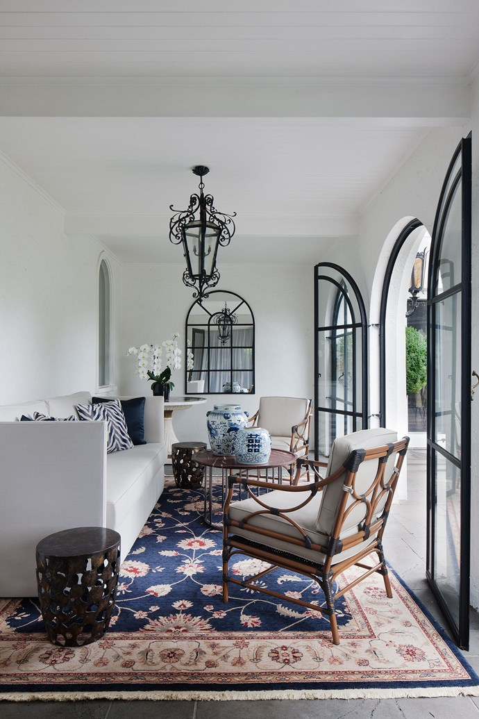 """Colonial Heir by [David Hicks](http://www.davidhicks.com/ target=""""_blank""""). This inviting nook in a grand mansion in Toorak, Vic, is so much more than simply a transition between an adjacent informal sitting area and the manicured garden. """"The clients wanted this room to be a comfortable extension of the living spaces,"""" says designer David Hicks, """"a room to sit and have a cup of tea, a cocktail or to relax and read a book. It had to be sophisticated, yet relaxed.""""  For this classic, yet casual, indoor/outdoor space, David """"loosely"""" drew his inspiration from the colonial mansions of Singapore. """"An eclectic mix of Asian antiques and contemporary furniture creates a colonial air."""" *Photography by Shannon McGrath.*"""