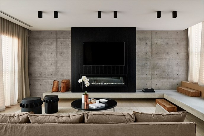 """Palette Pleaser by [Lawless and Meyerson](http://www.lawlessandmeyerson.com/ target=""""_blank""""). The pairing of concrete and timber is remarkably warm in this family room in Sydney's eastern suburbs, designed by interior designer Joanne Lawless of Lawless and Meyerson.  The addition of tan accents and textured linen makes for an incredibly calm environment, that Joanne says, """"was inspired by the finishes often seen in Belgian homes, typically drawing from a limited palette of natural materials."""" *Photography by Justin Alexander.*"""