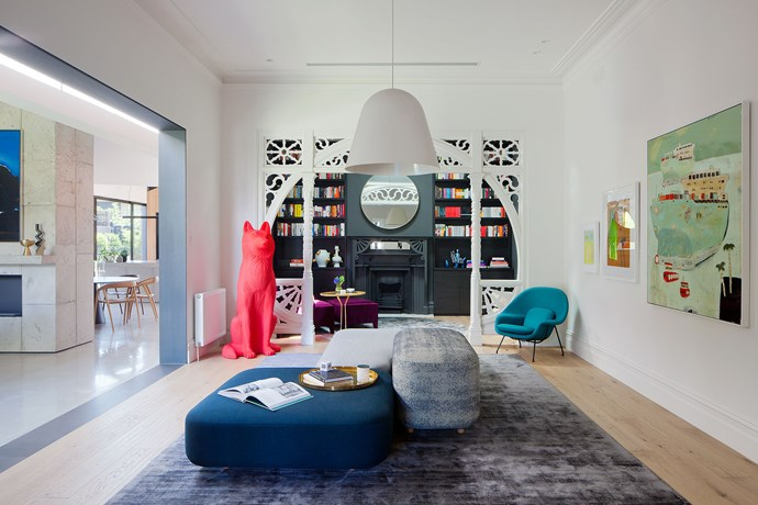 """Art House by [MIM Design](http://www.mimdesign.com.au/ target=""""_blank""""). The owners wanted this room to become a gallery, a light-filled place where visitors could comfortably linger and appreciate their quirky art collection. Interior designer Miriam Fanning celebrated the Edwardian heritage of the house by playing up the timber fretwork archway, but her daring use of colour combined with the clients' eye for art bring this period home into contemporary territory. Together they have brought to life the narrative of old and new. *Photography by Shannon McGrath.*"""