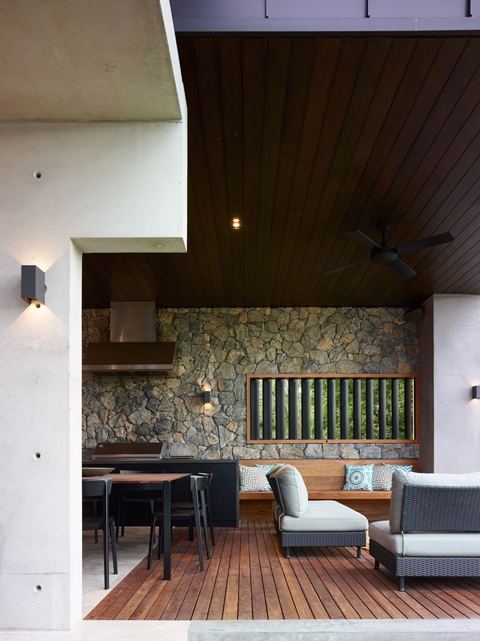"""For All Seasons by [Shaun Lockyer Architects](http://lockyerarchitects.com.au/ target=""""_blank""""). In this new build in Brisbane's inner west, the owners wanted an indoor/outdoor room that they could use throughout the year, as a hub for entertaining or quiet me-time. """"Inspired by the surrounding natural environment, the room uses a raw and robust palette of materials – stone, timber and concrete – muted tones and a play of light and textures,"""" says architect Shaun Lockyer. This chameleon has multiple personalities and uses – soaking up the sunshine or the warmth of the firepit, lounging in the shade while taking in the river vistas, or enjoying a barbecue with friends while being protected from the elements. *Photography by Scott Burrows.*"""