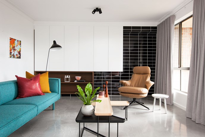 """Modern Marvel by [Woods and Warner](http://www.woodsandwarner.com.au/ target=""""_blank""""). When designers Sonia Warner and Jacinta Woods first saw this 1970s townhouse in Sydney's inner west, it was tired and desperately needed a pick-me-up. In this playful and dramatic living area, timber and concrete are a counterpoint to the crisp palette. """"Polished concrete was the masterstroke,"""" says Jacinta. """"It pays tribute to the Modernist era and adds gentle contrast to the stark white walls and gloss black tiling. This set the foundation for the bold block colours and the dusty midtones."""" """"Nordic influences complementing the architecture pull the look together,"""" adds Sonia. *Photography by Anneke Hill.*"""