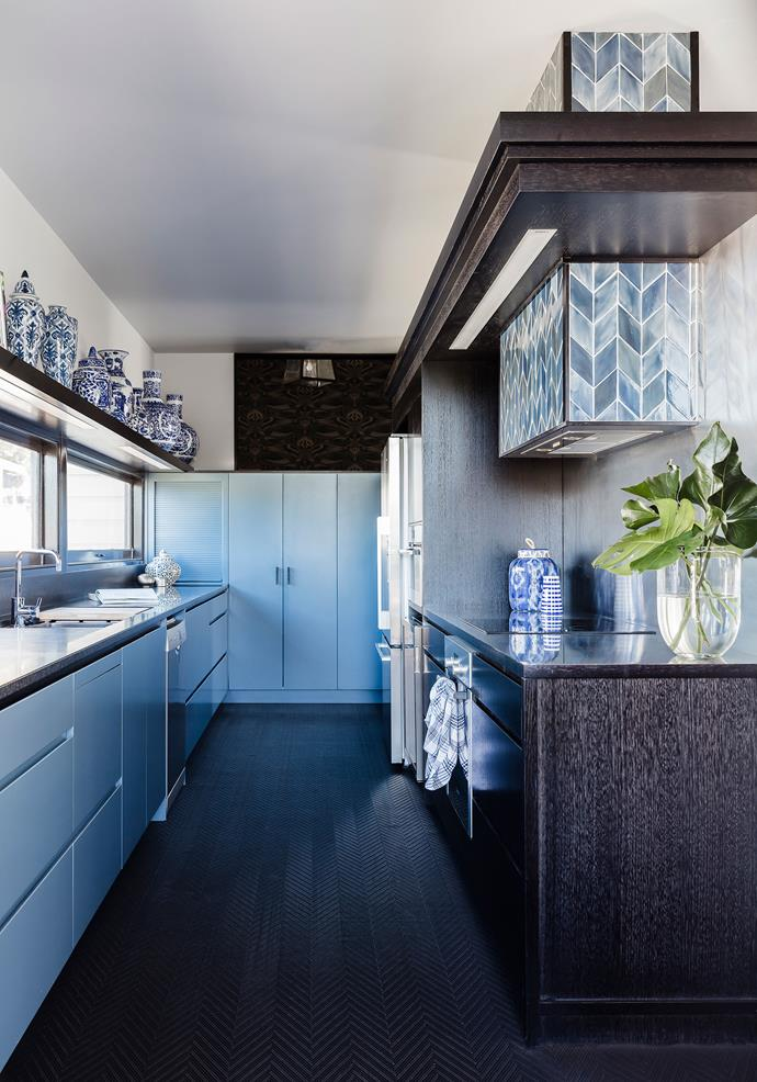 """Blue Days by COOP Creative Pty Ltd. This gorgeous galley kitchen is situated in the extension to an 1880s timber cottage in Brisbane. """"The owners wanted a kitchen that was light but not white,"""" says Rowena Cornwell, interior designer and director of Coop Creative.  They also sought a 'furnished' look, which inspired Rowena and Katherina to opt for cabinetry in two-pac Dulux Blue Oar and dark-stained American oak joinery. A matching bulkhead neatly encases the rangehood and task lighting while providing a crisp decorative detail.  Hand-glazed blue chevron tiles add texture and movement to the space. *Photography by Maree Homer.*"""