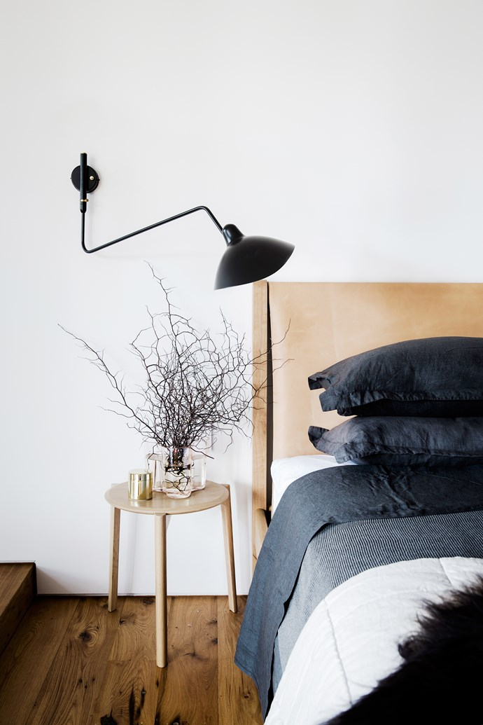 """Recycled French oak floorboards and a vegetable tanned leather bedhead on the 'Finley' bed from [Jardan](http://www.jardan.com.au/