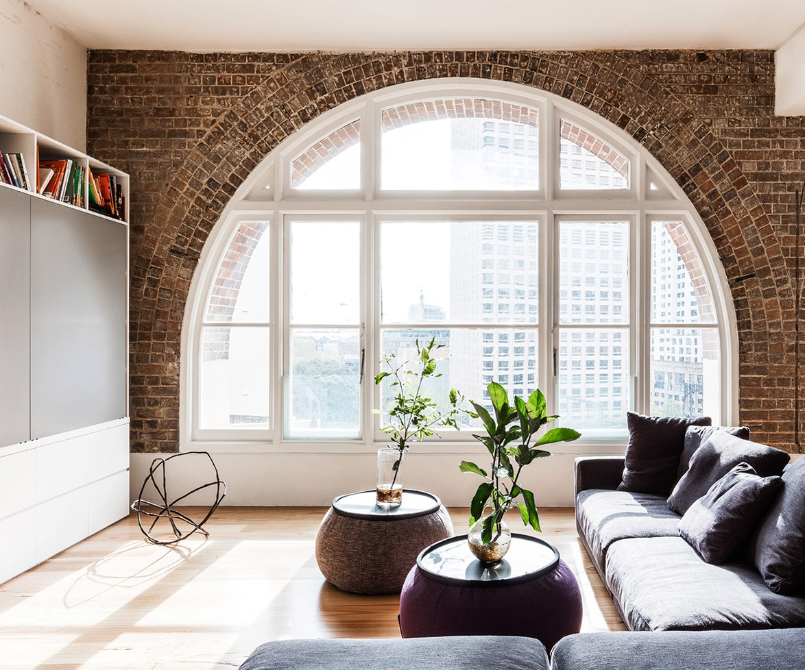 The living room in this [converted warehouse](http://www.homestolove.com.au/tea-merchant-warehouse-conversion-in-sydney-3958) is simplistic in its design, allowing the charming original architecture to shine in this tranquil refuge high above the city. Photo: Tom Ferguson / Belle